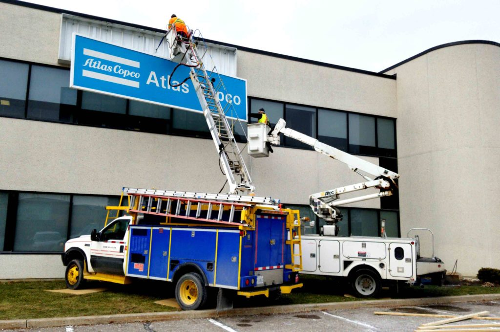 Atlas Copco signs being brought down by SIgnarama Toronto